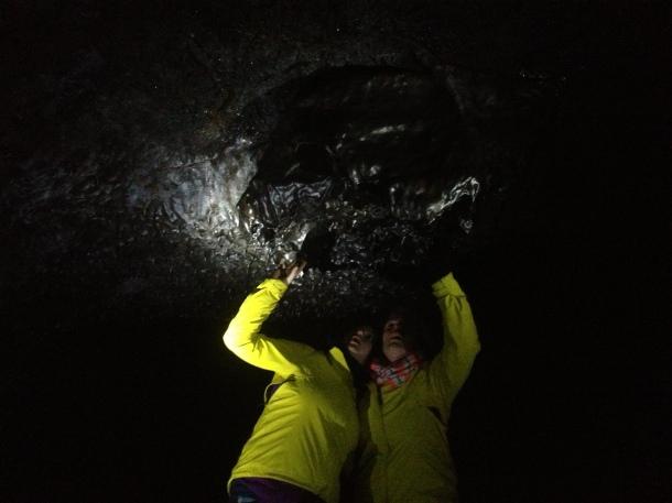 In the tunnels, a black rock chandelier